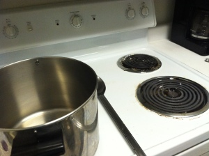 Clean-ish stove top. Top: small burner. Bottom: big burner. This stove has seen over 50 brew days. Like a champ.