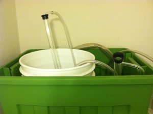 Storing brewing equipment in this nice green tote.